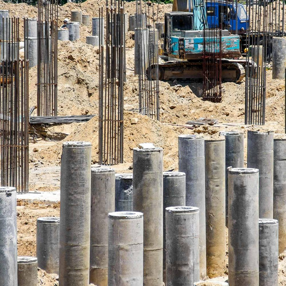 Piles in ground at pile driving site